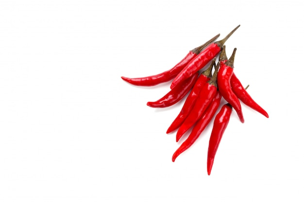 Fresh red chili peppers over white background with copy space view from above