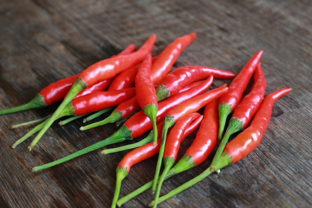 Fresh red chilli on old wood