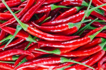 Fresh red chilli with green stalk - close up