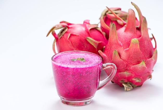 Fresh red dragon (pitaya) fruit juice in glass mug.