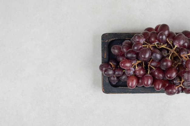Fresh red grapes on black plate
