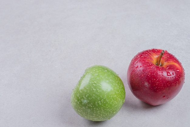 Fresh red and green apples on white background.