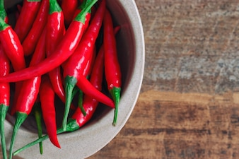 Fresh red hot chili peppers in bowl