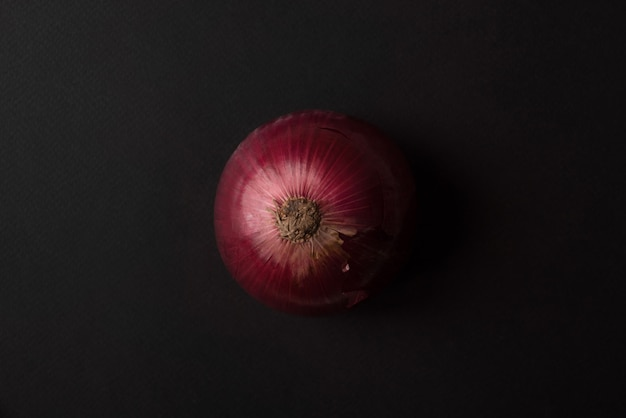 Fresh red onion over black