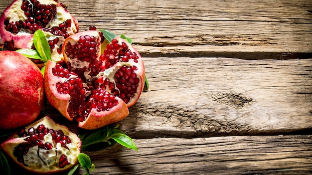 Fresh red pomegranate with leaves
