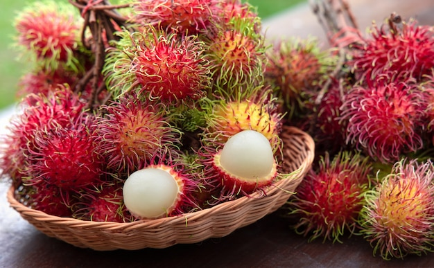 Fresh red rambutan fruit in basket