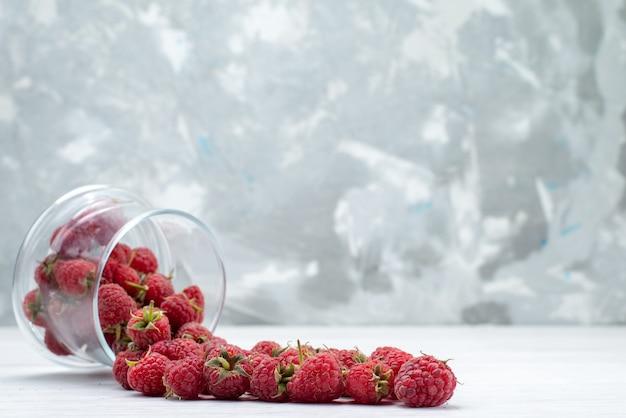 Fresh red raspberries on light