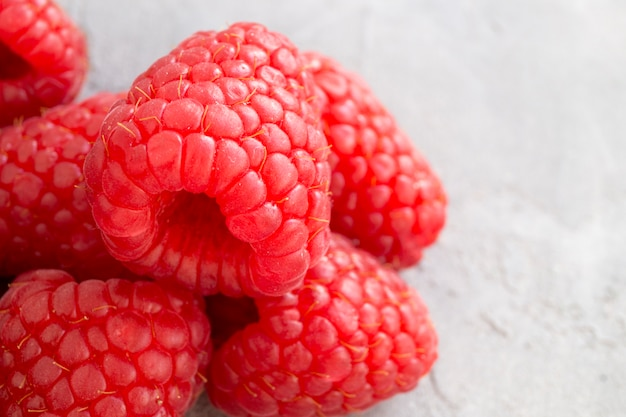 Fresh red raspberries on the table, close up.