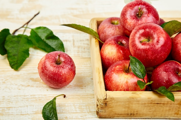 Fresh red ripe apples fruits in the wooden box