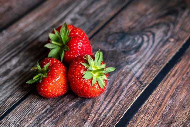 Fresh red scottish strawberries on top of wooden table
