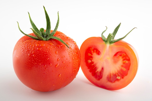 Fresh red tomato and half tomato