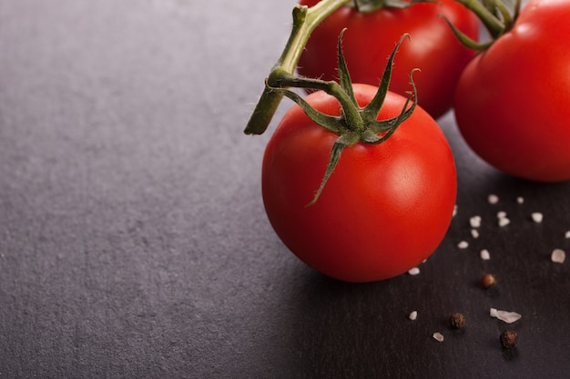 Fresh red tomato with a branch