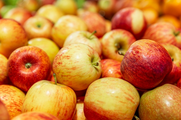 Fresh red-yellow apples on a counter in a supermarket. healthy eating and vegetarianism. close-up.