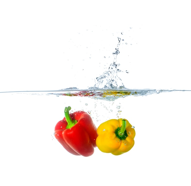 Fresh red and yellow paprika splash in water