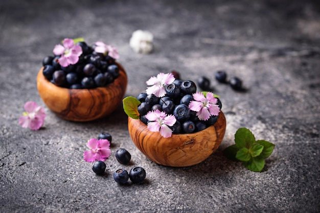 Fresh ripe blueberries in wooden bowl
