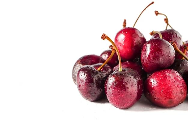 Fresh ripe cherries on white background. copy space