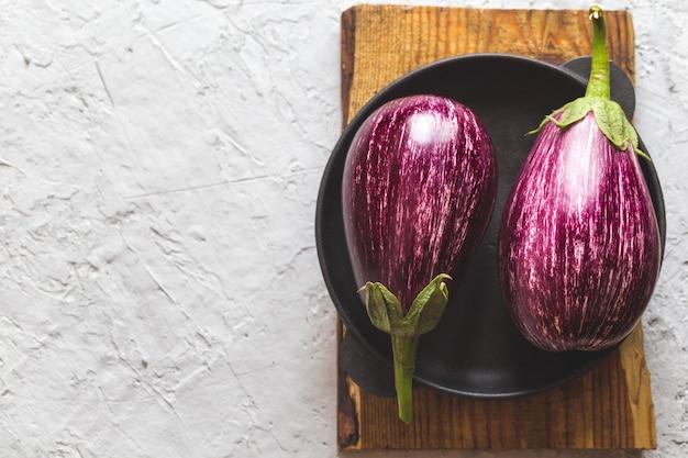 Fresh ripe eggplants on a cutting board