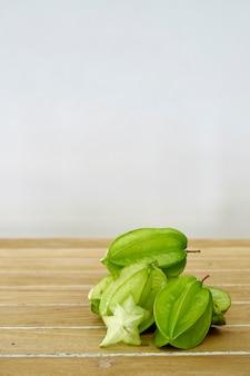 Fresh ripe fruit carambola on wooden table