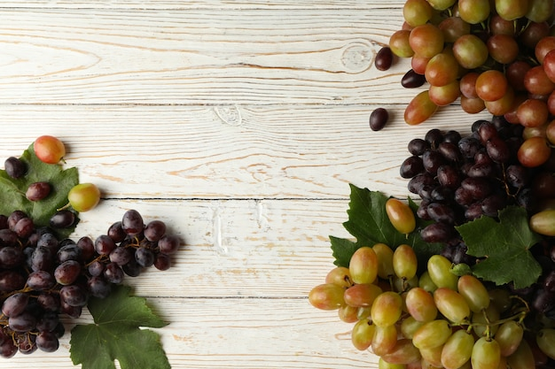 Fresh ripe grape on white wooden
