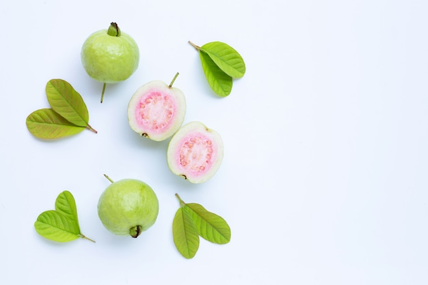 Fresh ripe guava and slices with leaves. top view