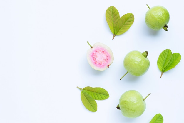 Fresh ripe guava and slices with leaves.