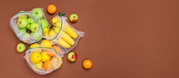 Fresh ripe and juicy fruits in reusable eco friendly mesh bags.