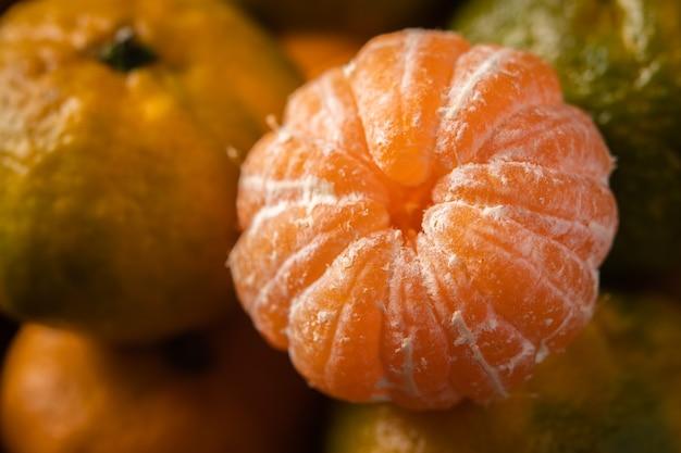 Fresh ripe mandarins background close up, macro, selective focus
