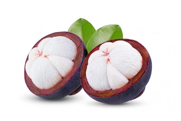 Fresh ripe mangosteens (garcinia mangostana) or manggis with leaf on white background.