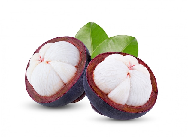 Fresh ripe mangosteens with leaves on white background