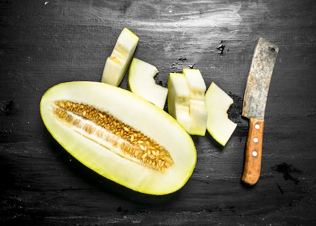 Fresh ripe melon on the black chalkboard