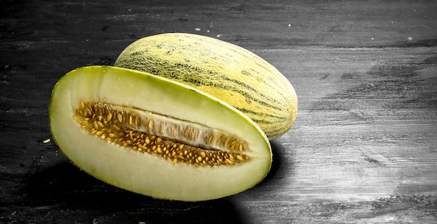 Fresh ripe melon. on the black chalkboard.