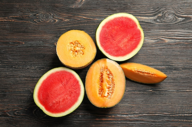 Fresh ripe melons and watermelon on wooden