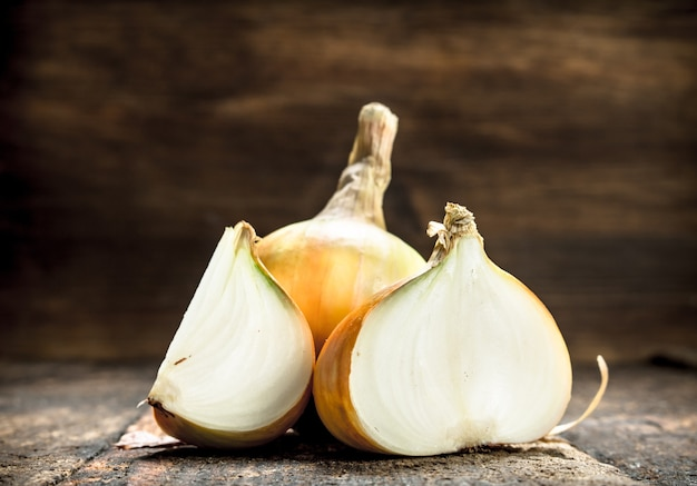 Fresh ripe onions. on a wooden background.