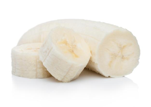 Fresh ripe organic banana sliced pieces on white surface