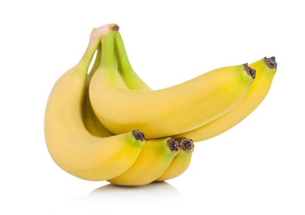 Fresh ripe organic bananas cluster on white surface