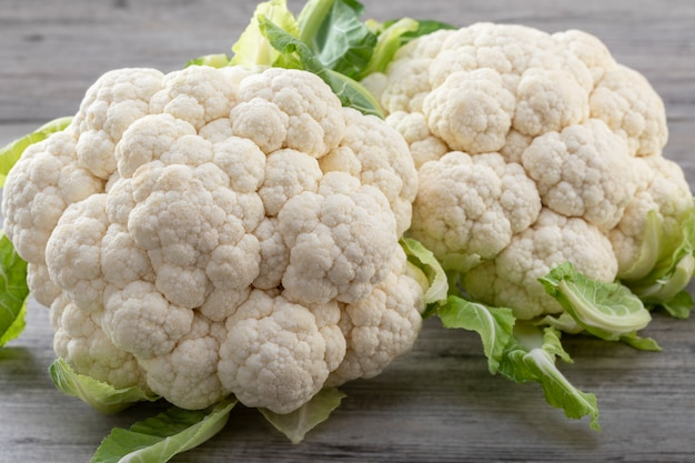 Fresh ripe organic cauliflower on wooden background. healthy eating