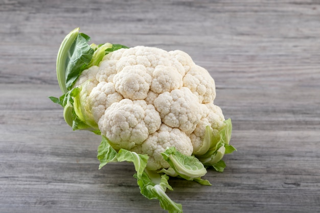 Fresh ripe organic cauliflower on wooden table. healthy eating concert