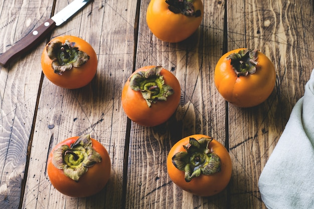 Fresh ripe persimmon on a wooden table