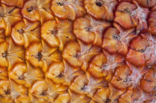 Свежий спелый ананас текстуры, крупным планом вид