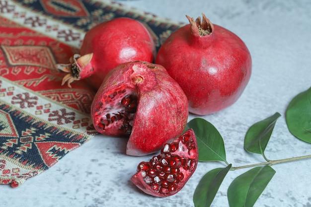 Fresh ripe pomegranates on stone background.