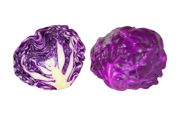 Fresh ripe purple cabbages one whole and one cut in half isolated on white background
