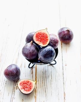 Fresh ripe purple figs on light,  top view