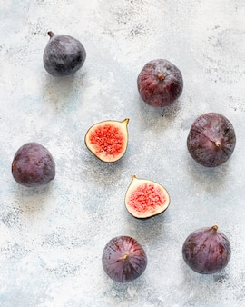 Fresh ripe purple figs on light,  top view