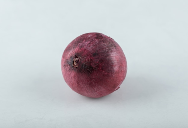 Fresh ripe red onion on white background.