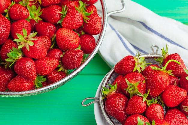 Fresh ripe red strawberries on garden's table
