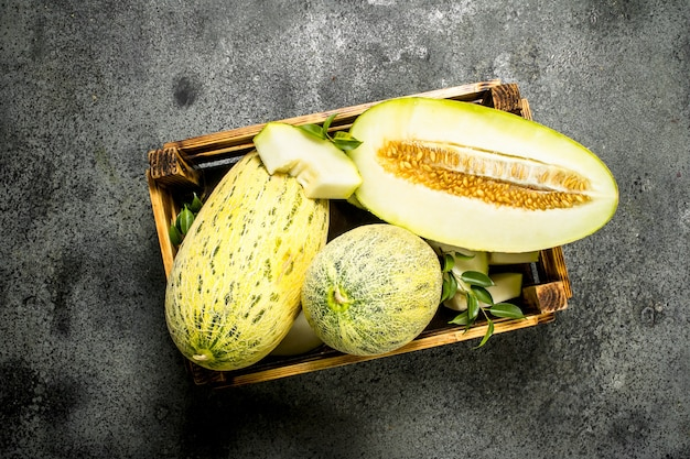 Fresh ripe sliced melon on a rustic background