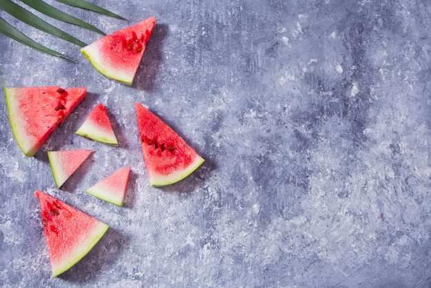 Fresh ripe sliced watermelon on gray