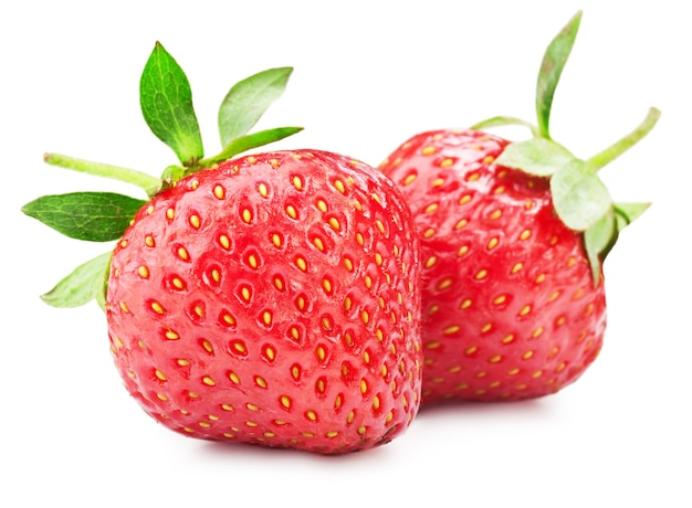 Fresh ripe strawberries on a white surface