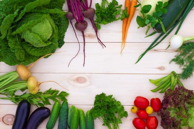 Fresh ripe summer vegetables, health organic vegan food on wooden