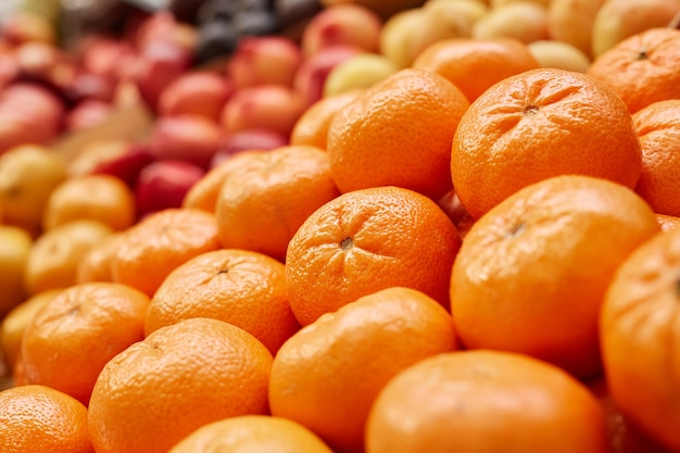 Fresh ripe tangerines ready for sale at stand in farmers market